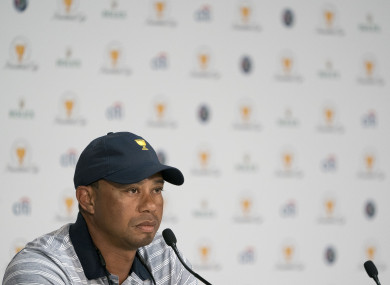 U.S. Team assistant captain Tiger Woods addresses the media in a press conference during the practice round of The Presidents Cup golf tournament.