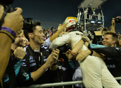Mercedes' British driver Lewis Hamilton celebrates with teammates after winning the Formula One Singapore Grand Prix in Singapore.