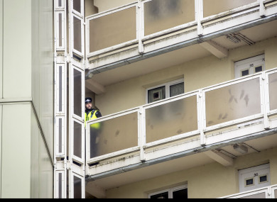 A police officer leaves Newcastle House in Bradford, where the 18-month-old baby died following a fall from a sixth-floor window.
