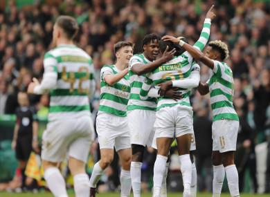 The Celtic players congratulate match-winner Olivier Ntcham.