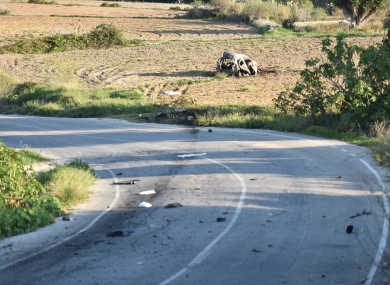 The wreckage of the car of investigative journalist Daphne Caruana Galizia lies next to a road near the town of Mosta.