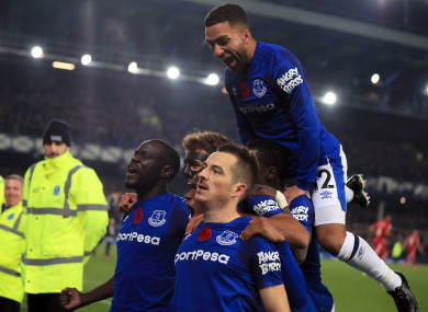 Everton's Leighton Baines (centre, bottom) celebrates scoring his side's third goal of the game from the penalty spot.