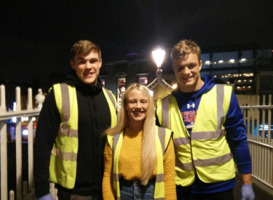Garry Ringrose and Josh van der Flier with Natasha Morgan of Feed Our Homeless.