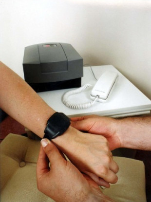 File Photo: A small electronic monitoring device used in the UK judicial system