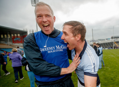 Na Piarsaigh manager Shane O'Neill celebrates with defender Niall Buckley.