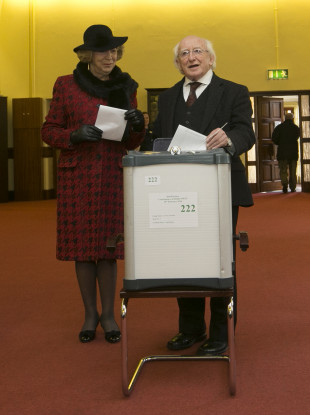 Sabina and President Michael D Higgins voting in 2016.