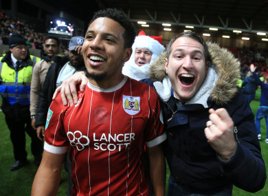 Korey Smith celebrates with a Bristol supporter after beating Manchester United on Wednesday.