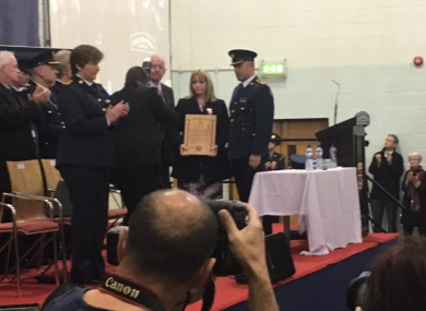 Minister Flanagan presents Nicola Golden with an award honouring her husband's bravery.
