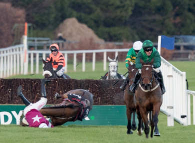 Paul Townend onboard Footpad on his way to winning as Davy Russell falls on Death Duty at the last.