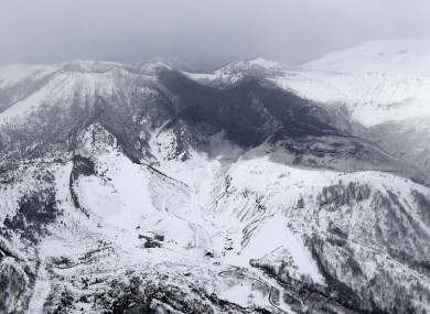 Ashes from Mount Kusatsu-Shirane cover near its summit after its eruption in Kusatsu, Gunma prefecture, central Japan.