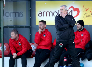 Cotter (left) in the dug-out with Liam Kearney and Caulfield.