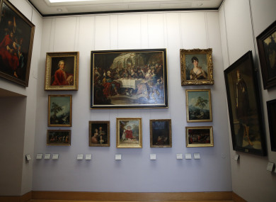 Paintings looted by Nazis during World War II, are on display at the Louvre museum, in Paris