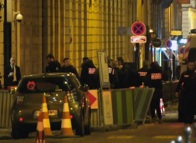 French police attend the scene outside the Ritz Hotel in Paris