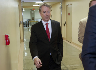 Senator Rand Paul walks to the senate chamber in the Capitol.