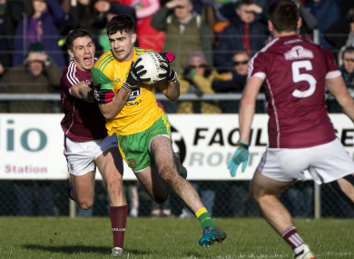 Donegal's Caolan McGonagle and Galway's Shane Walsh.