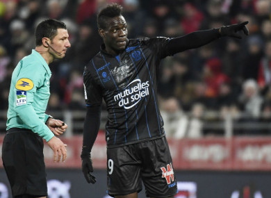 Nice's Mario Balotelli remonstrates with the referee.