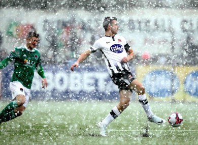 Dundalk's Michael  Duffy and Colm Horgan of Cork City in the snow.