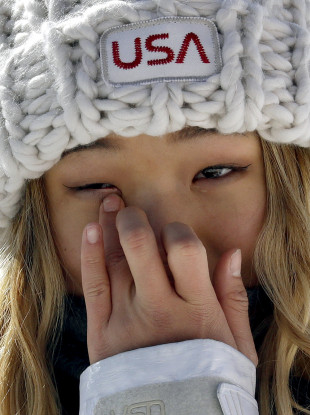 Chloe Kim, of the United States, wipes away a tear after winning gold in the women's halfpipe finals at Phoenix Snow Park.