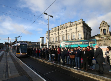 Passengers at the Luas Heuston station stop.