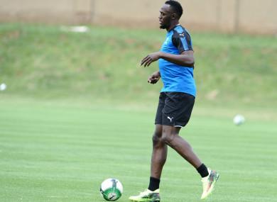 Usain Bolt enjoys a game of football.