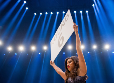 A ring card girl holds up a ring card at the boxing ring at the Esprit Arena in Duesseldorf, Germany.