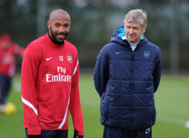 Henry pictured alongside Arsenal boss Arsene Wenger in 2011.