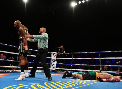 Browne lies on the canvas as Whyte celebrates victory.