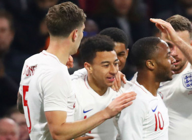 Lingard is congratulated by team-mates.