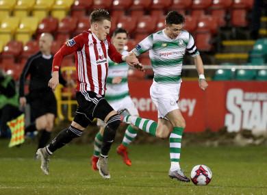 Derry City's Ronan Curtis with Ronan Finn of Shamrock Rovers.
