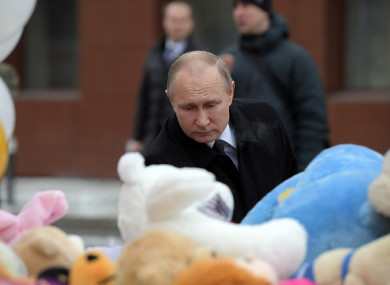 Putin pays respect to the victims of the fire at a shopping centre in Kemerovo
