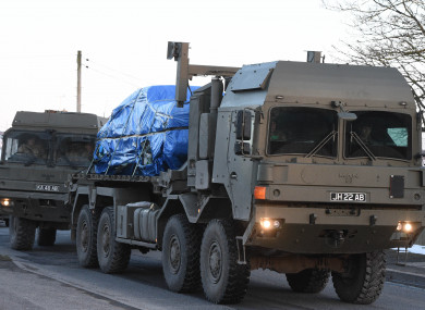 A vehicle of interest wrapped up in blue tarpaulin near the scene of the poisoning