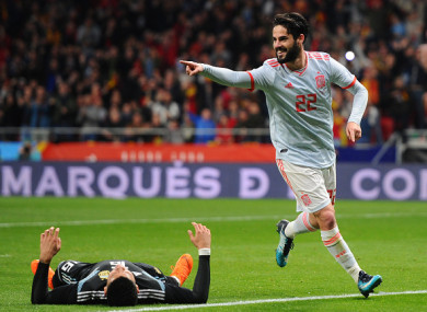 Isco of Spain celebrates after scoring his side's third goal.
