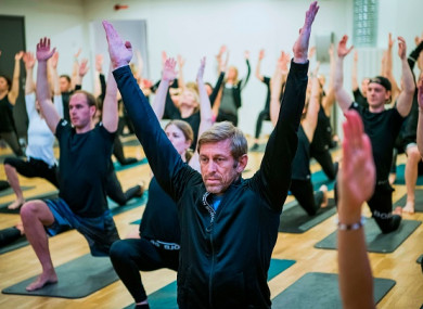Bjoern Borg CEO Henrik Bunge (C) is pictured during a yoga class in Stockholm
