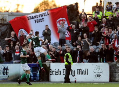 Aaron McEneff celebrates in front of the travelling fans.