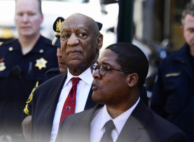 Bill Cosby looks around before he leaves the Montgomery County Courthouse.