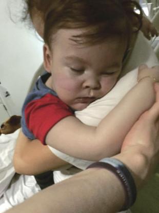 Alfie Evans with his mother Kate James at Alder Hey Hospital, Liverpool, England