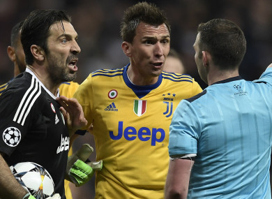 Buffon confronts Oliver after his controversial decision.