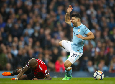 Aguero is caught late by Man United's Ashley Young during the recent derby.