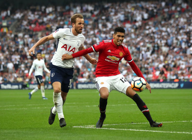 Smalling protects the football from Harry Kane.