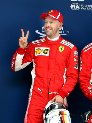 First-placed Ferrari's driver Sebastian Vettel of Germany poses for photos after the qualifying of Formula 1 2018 Chinese Grand Prix in Shanghai.