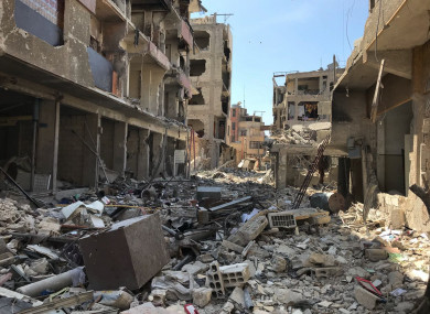 Rubble fills a street in Douma, the site of a suspected chemical weapons attack, near Damascus, Syria.
