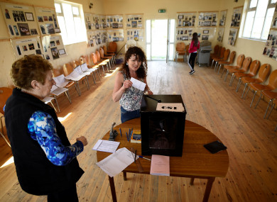 Presiding officer Carmel McBride looks on as votes are cast on Inishboffin yesterday.