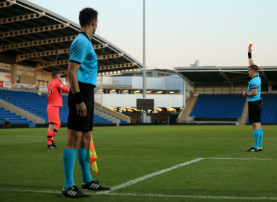 415f22b5b Ireland goalkeeper Jimmy Corcoran is shown a red card by referee Zbynek  Proske during the shootout