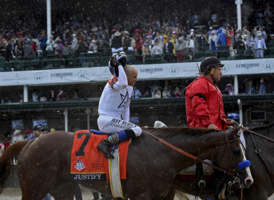 Jockey Mike Smith smiles after riding Justify to win the 144th running of the Kentucky Derby, the wettest in history.
