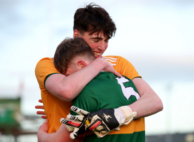 Kerry's Marc Kelliher and Dan McCarthy hug after the victory.