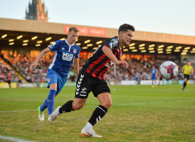 Eoghan Stokes in action against Jamie Lennon at Dalymount Park.