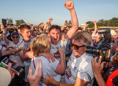 David Hyland celebrates Kildare's victory with his mother Maire after the game.