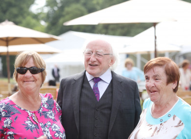 Michael D Higgins with Mairead Manley and her twin sister Breda Kennedy, who were former residents in the Goldenbridge orphanage.