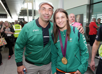 Gold medal winner Katie Taylor poses with her medal with her father Pete.