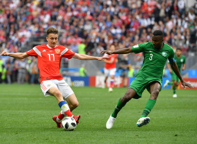 Russia's Aleksandr Golovin (L) vies with Saudi Arabia's Osama Hawsawi during the opening match of the 2018 FIFA World Cup in Moscow.